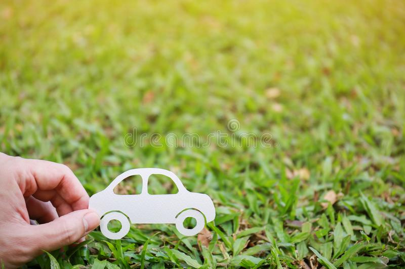 Paper cut of car on green grass background royalty free stock photo