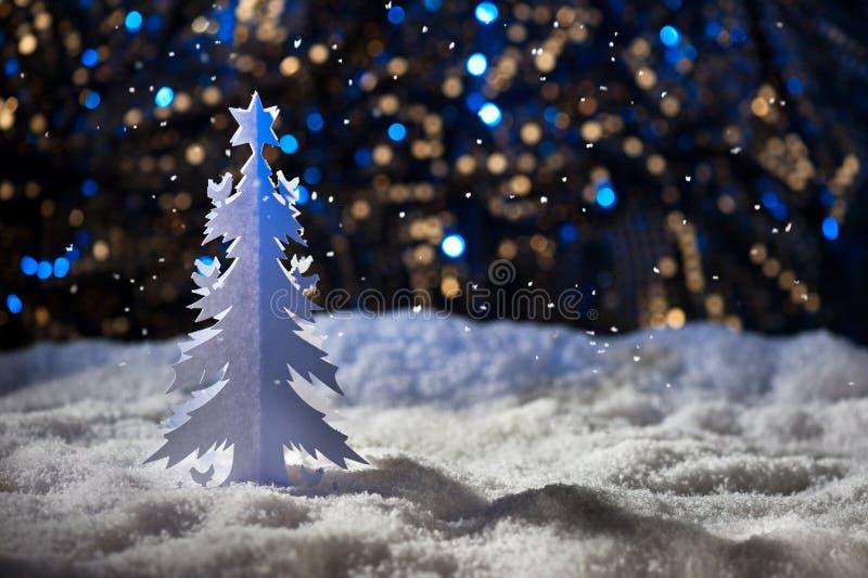 Paper cut christmas tree. In snowy winter wonderland royalty free stock photo