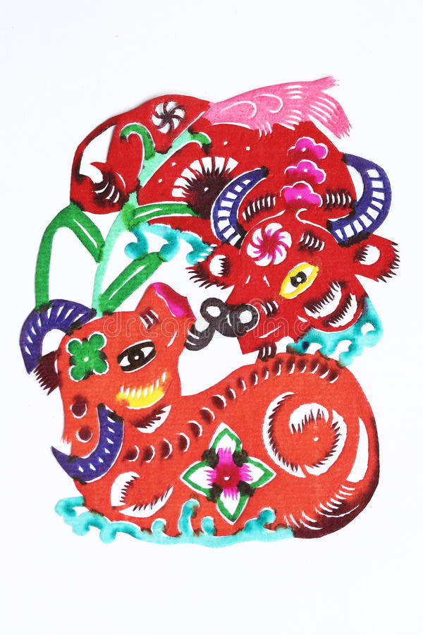Paper-cut of double ox. Paper-cutting is a traditional Chinese folk art. Paper-cut of double ox represents good harvest and happy life royalty free stock photography