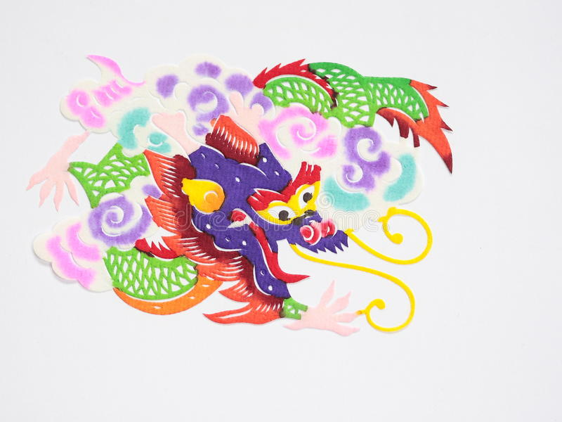 Paper-cut of dragon. Paper-cutting is a traditional Chinese folk art. Paper-cut of a dragon represents good luck and power royalty free stock photos