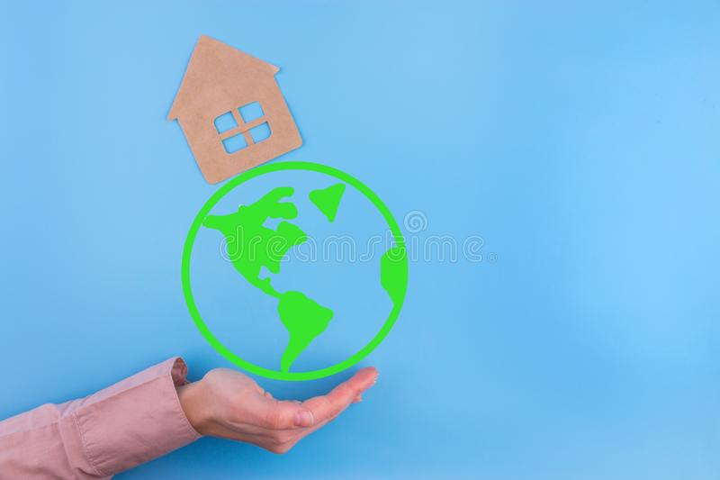 Paper cut of eco house. On blue background stock image