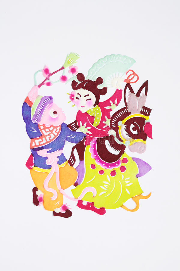 Paper-cut of folk dance. Paper-cutting is a traditional Chinese folk art. Paper-cut of folk dance shows the celebration of holiday royalty free stock photography