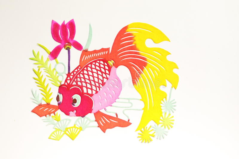 Paper-cut of golden fish. Paper-cutting is a traditional Chinese folk art stock photo