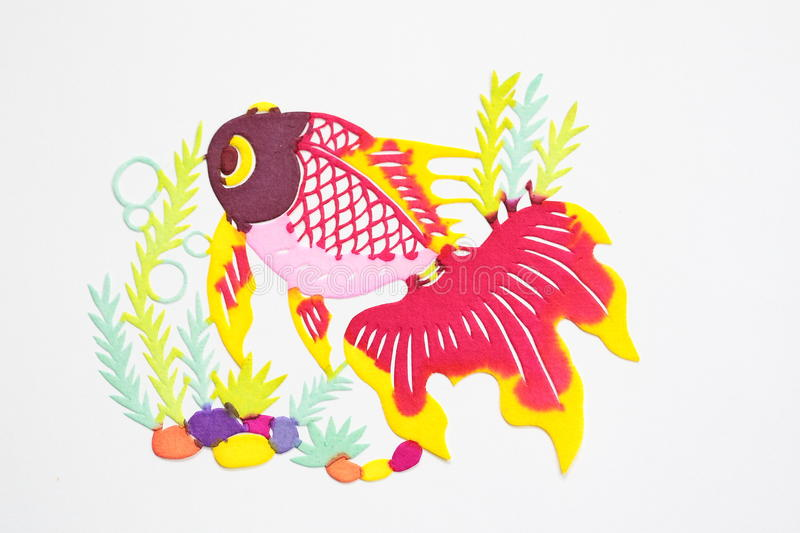 Paper-cut of golden fish. Paper-cutting is a traditional Chinese folk art. Paper-cut of golden fish represents good luck and happiness stock images