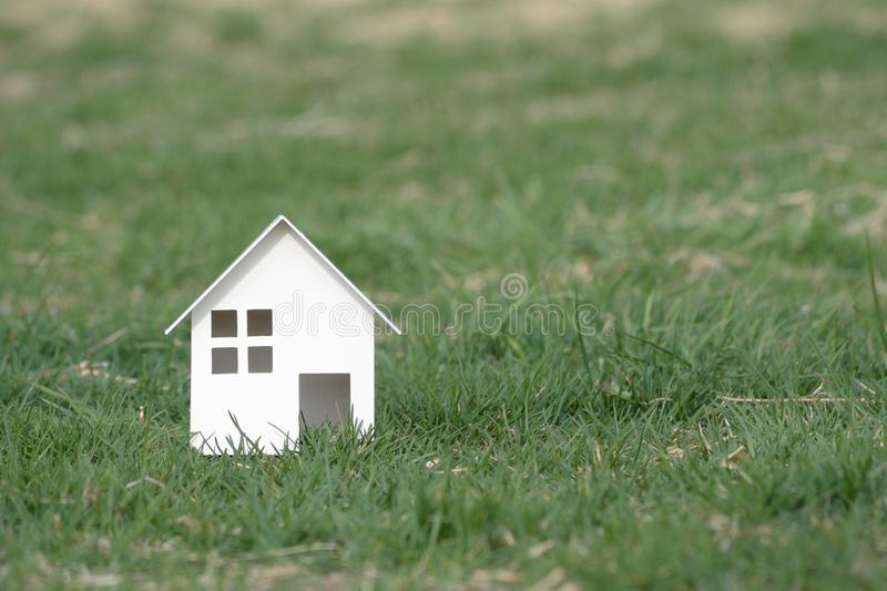 Paper cut of house on nature background with copy space.  royalty free stock image