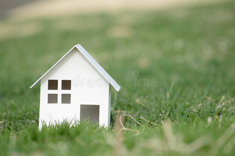 Paper cut of house on nature background with copy space.  royalty free stock photography