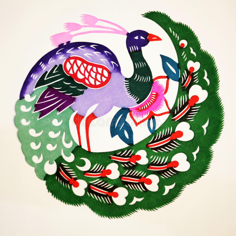 Paper-cut of Peacock. Paper-cutting is a traditional Chinese folk art. Paper-cut of a peacock which symbolizes good luck royalty free stock image