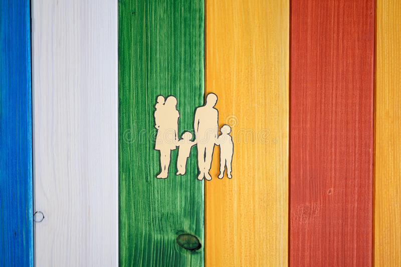 Paper cut silhouette of a family with three children stock photo