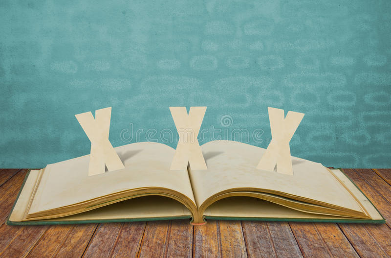 Paper Cut Of XXX Adult On Book Royalty Free Stock Images