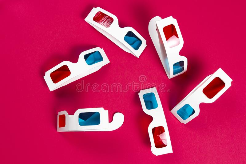 Paper 3d glasses on a pink background. film concept. Cinema in 3d stock photos