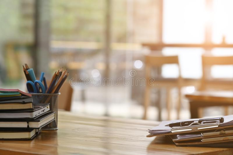 Paper document files and pen business equipment on wooden desk stock image