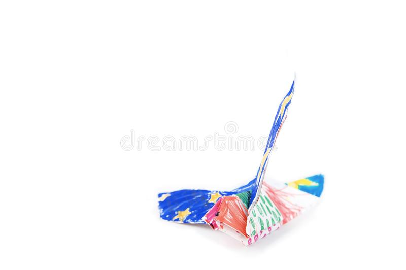 Paper eagle origami isolated on white background. bird flying colored by felt tip pen royalty free stock photography