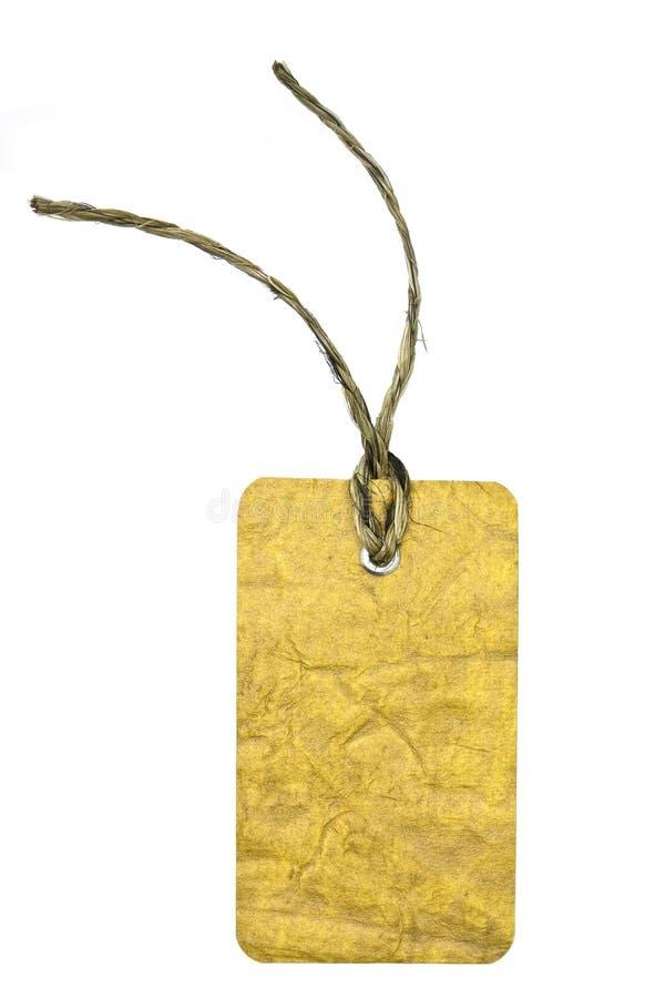 paper etikett för guld arkivbild