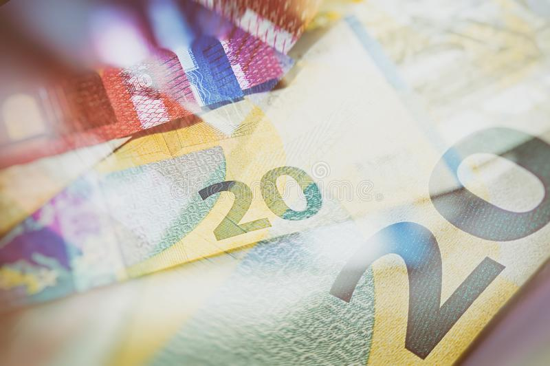 Paper euro notes. Twenty euros. Blurred Background. stock images