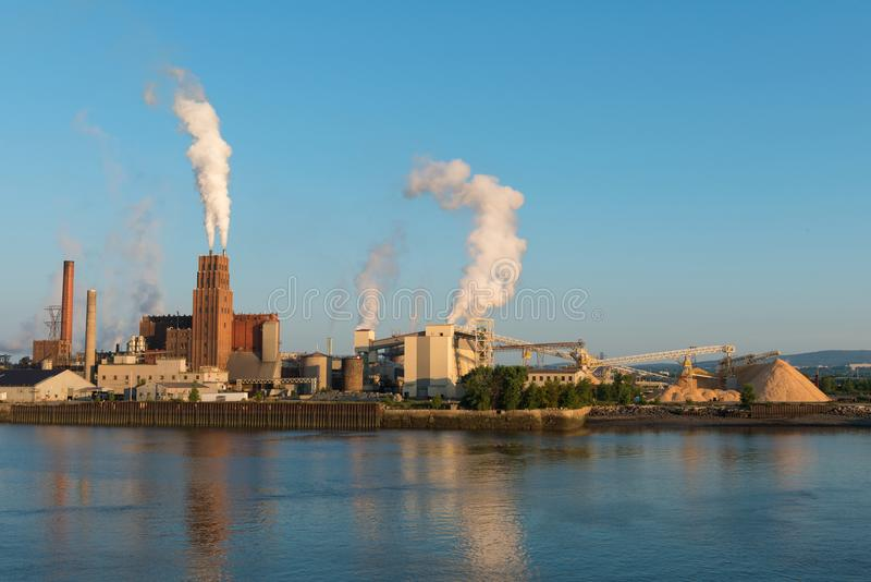 Riverside paper factory. Paper factory on the St. Charles River, Quebec City, Canada stock photo