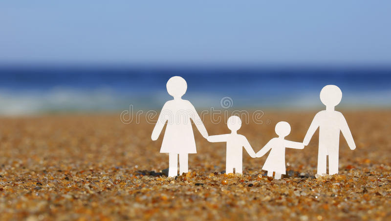 Paper Family On The Beach. Family Stock Photo