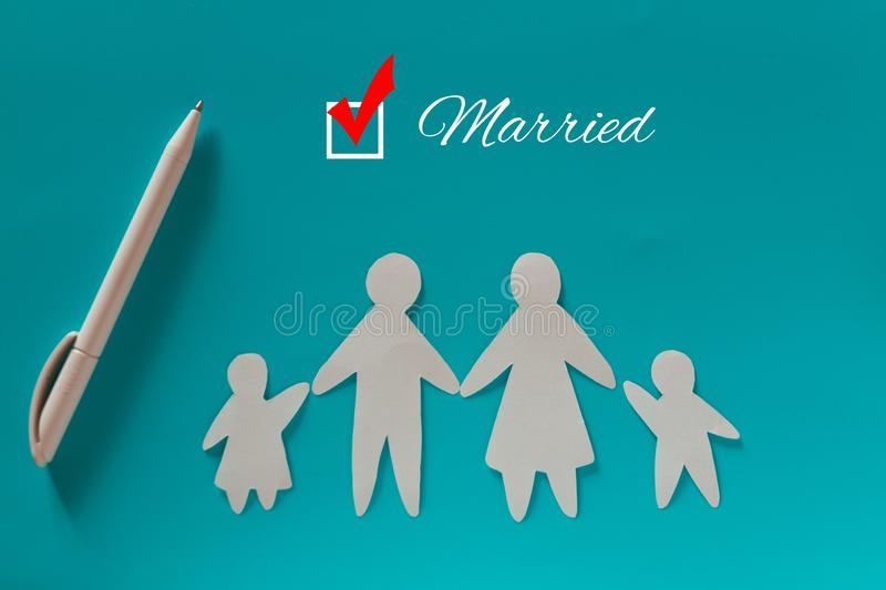 Paper family on blue background stock photo