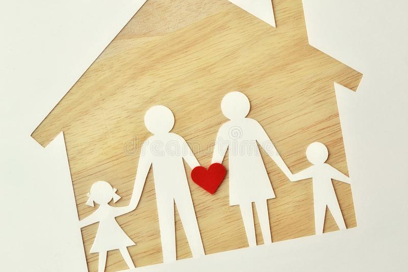 Paper family cut-out and house - Love and family union concept stock image