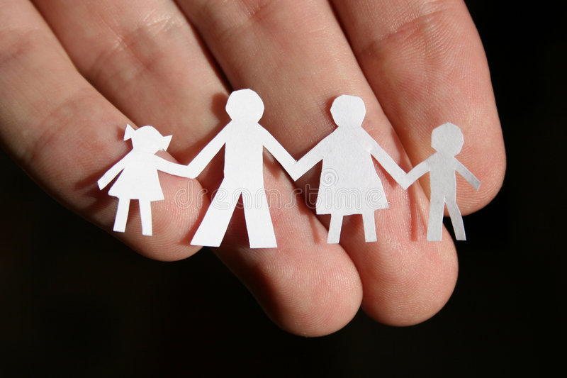 Paper family on hand royalty free stock photos