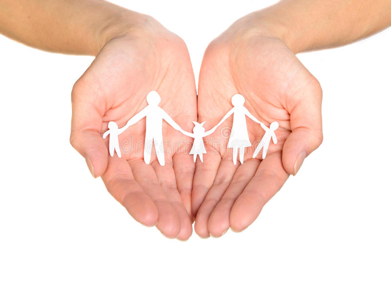Paper family in hands stock photos