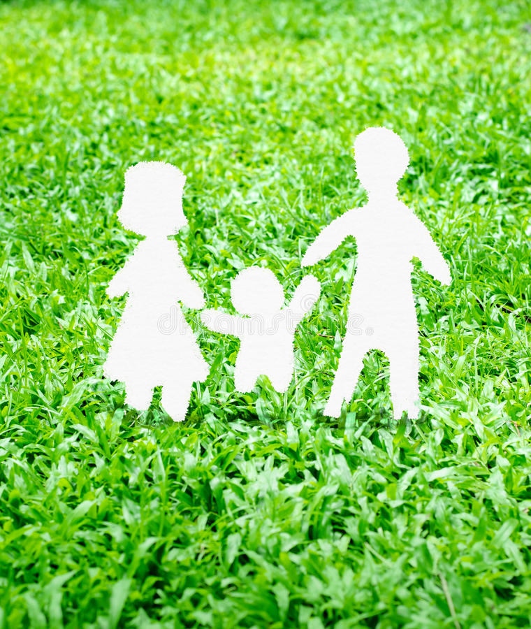Paper Family icon on green grass royalty free stock image