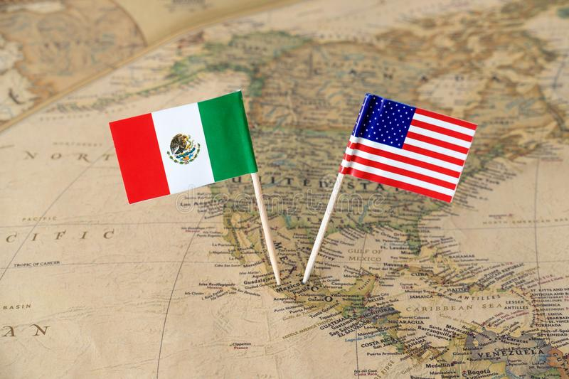 The United States of America and Mexico flag pins on a world map, political relations concept royalty free stock images