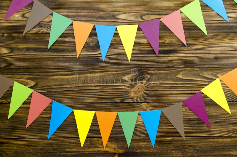 Paper flags party garland on wooden background stock images