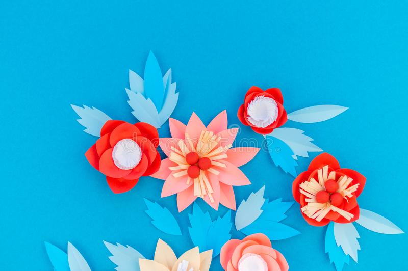 Paper flower for Christmas decor. Color coral fashion pastel. Handmade children's creativity. Blue background. Cozy new year stock images