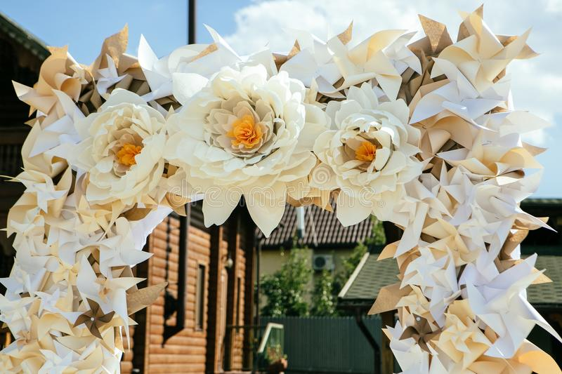 Paper flowers in wedding decor luxury wedding decorations for download paper flowers in wedding decor luxury wedding decorations for ceremony wedding arch stock junglespirit Image collections