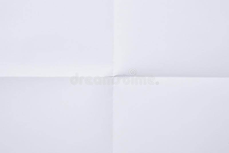 Paper folded in four. White sheet of paper folded in four royalty free stock photography