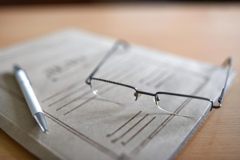 Paper folder with court documents on the table, glasses, pen.  royalty free stock photo