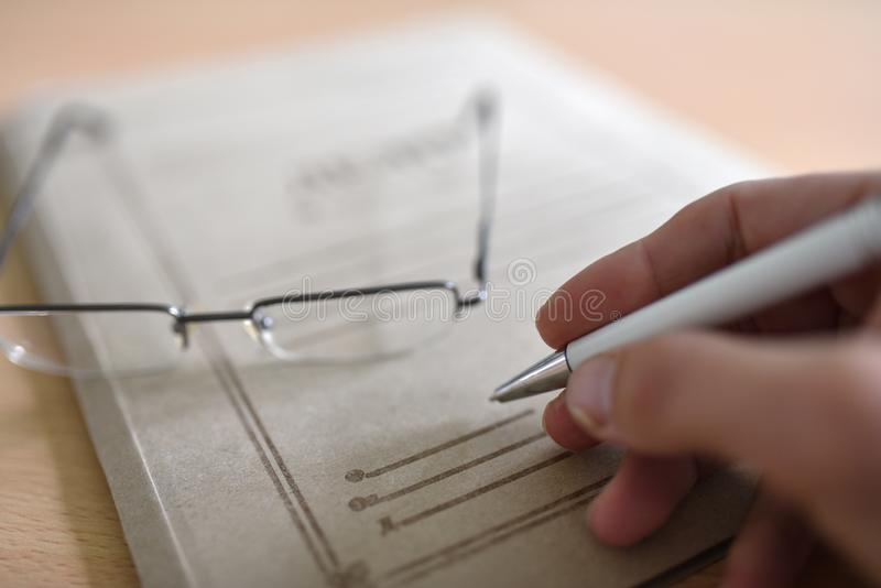 Paper folder with court documents on the table, glasses, pen.  stock photography