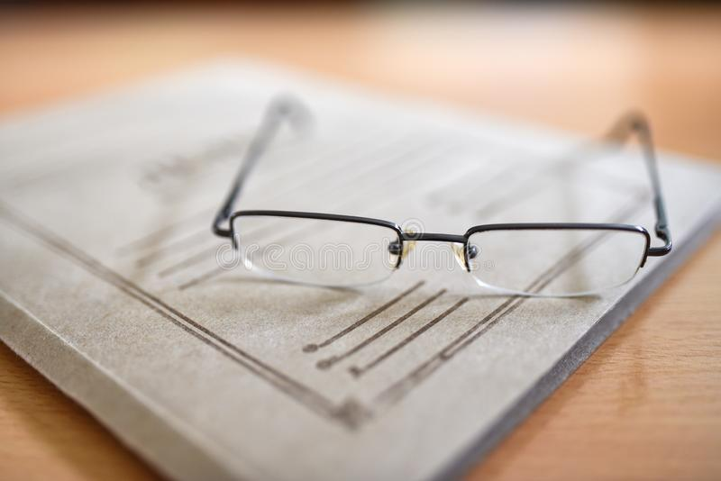 Paper folder with court documents on the table, glasses, pen.  royalty free stock photos