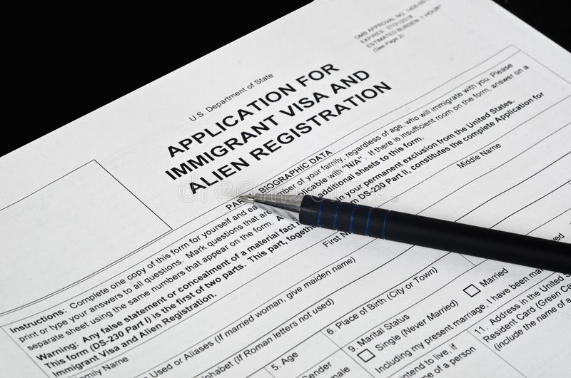 Paper Form immigration visa lies on the black surface royalty free stock image