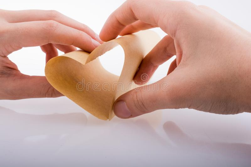 Paper forming a heart shape royalty free stock images