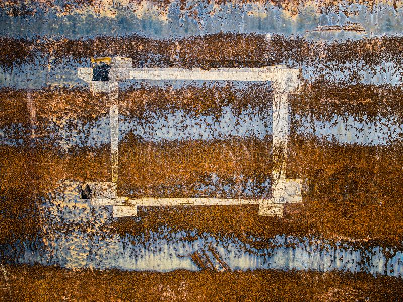 Paper frame left on eroded metal surface, abstract grunge background royalty free stock photos