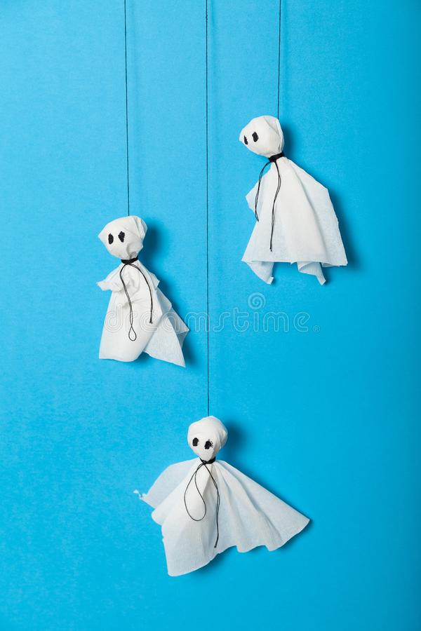Paper ghosts, scary halloween craft kids concept stock images