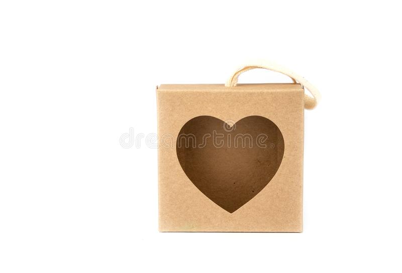 Paper gift box . Brown paper box with Heart shape window on white background royalty free stock image