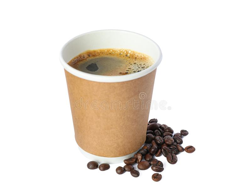 Paper glass with coffee beans isolated on white background. Coffee time accessories stock photography