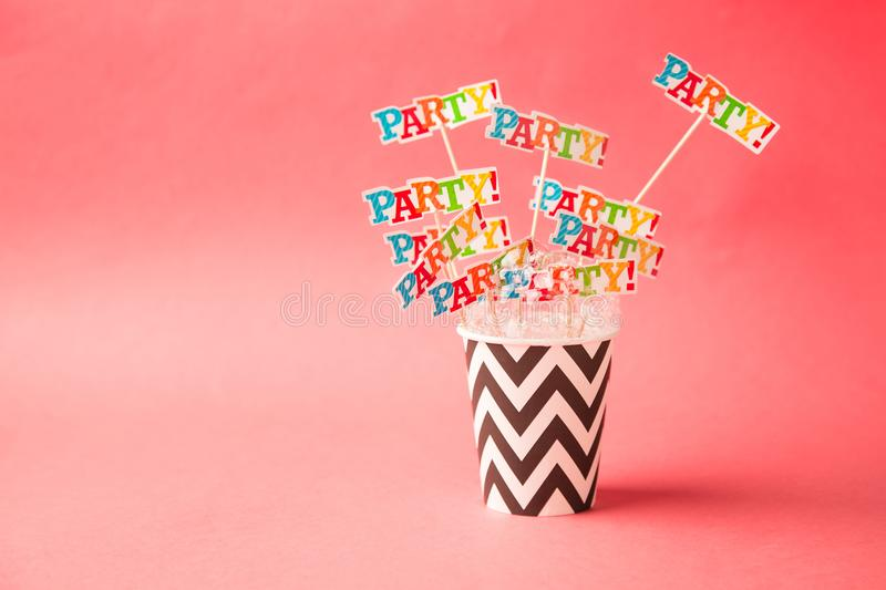 Paper glass party on a pink background. Beach cheers celebration royalty free stock photo