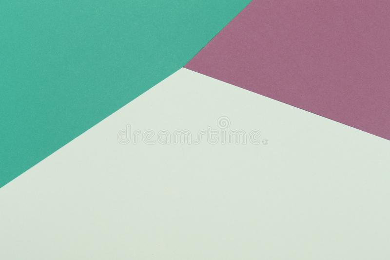 Paper green, burgundy, yellow empty background, geometrically located. Color blank for presentations, copy space stock photography