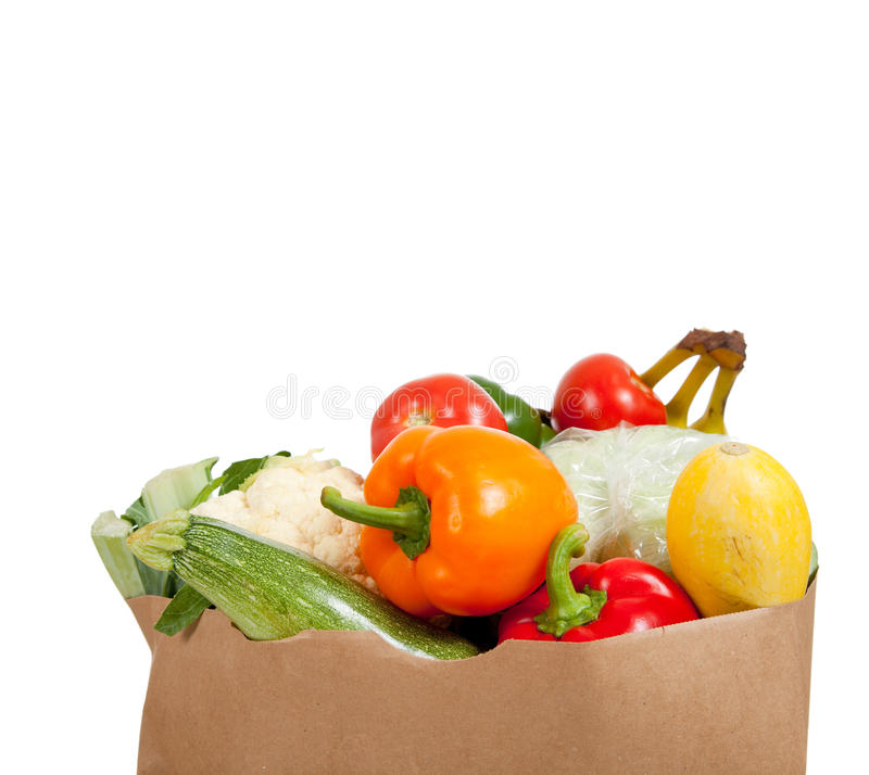 Paper grocery sack with vegetables on white stock image