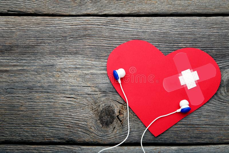 Paper heart with adhesive bandage royalty free stock photos