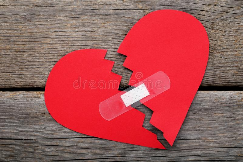 Paper heart with adhesive bandage stock images