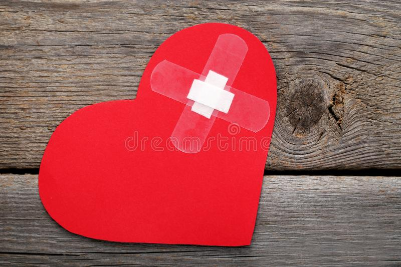 Paper heart with adhesive bandage stock photography