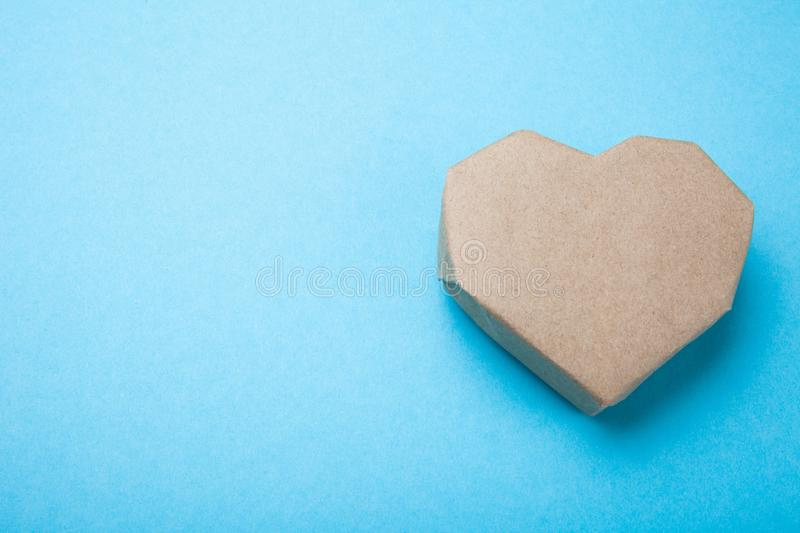 Paper heart on a blue background, empty space for text stock image