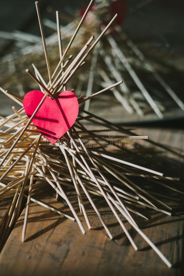 The paper heart lies on the wooden sticks. idea royalty free stock photo