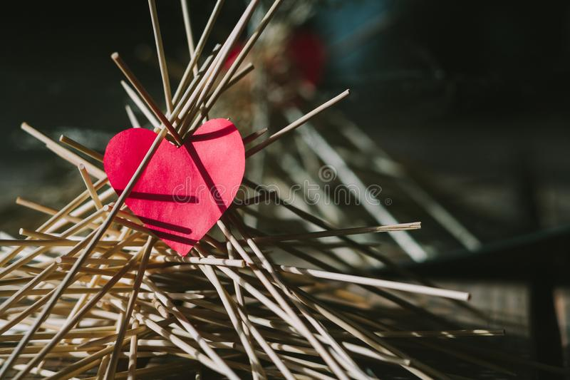 The paper heart lies on the wooden sticks. idea stock photos