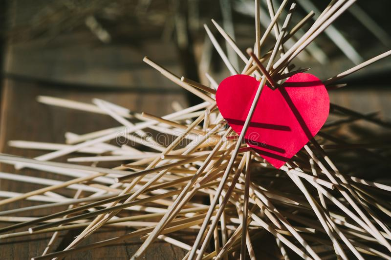 The paper heart lies on the wooden sticks. idea stock photo