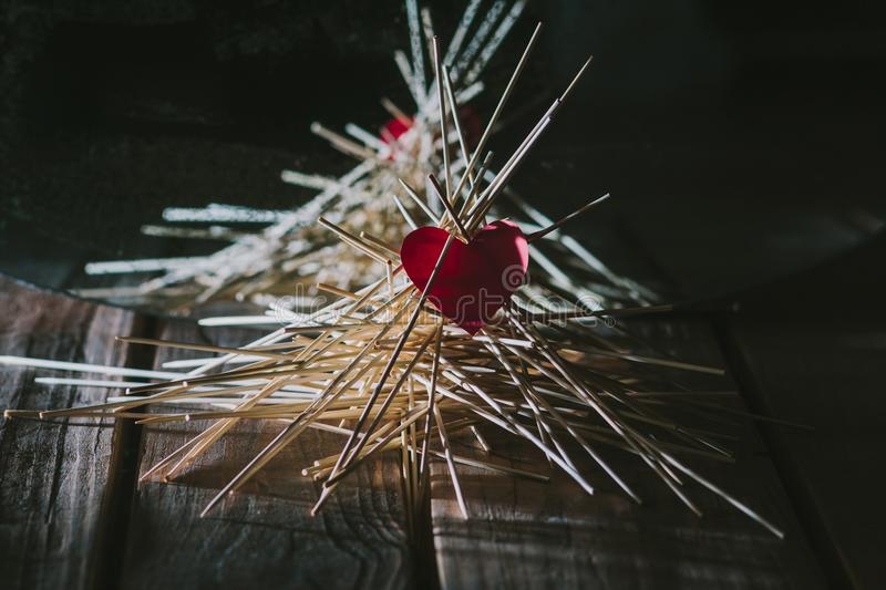 The paper heart lies on the wooden sticks. idea stock image